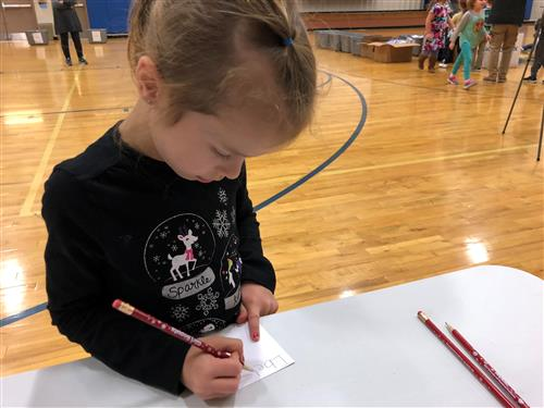 Photo of Girl Writing a Card