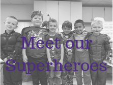 six young males dressed up in superhero costumes with Meet Our Superheros written on it