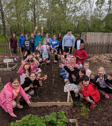 Middle School Students and 1st graders Team Up in the Garden! What a fun day in the garden