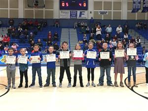 10 Students with Certificates standing on the FCHS Basketball Court