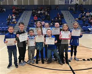 10 Students with Certificates in the middle of the FCHS Basketball Court