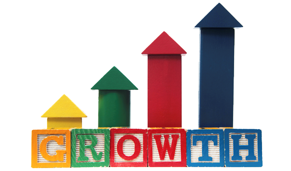 Primary blocks with arrows up that spell the word growth