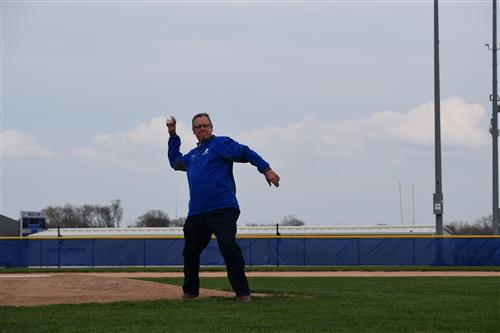 Jeff Mercer throwing out the first pitch.