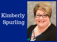 blue background, head shot of Kimberly Spurling and her name written to the site.