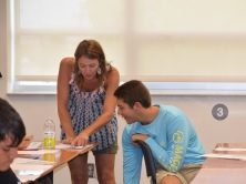 Christa Intriago helps student in Spanish I and II prep course.