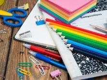 colored pencils, notebooks, paperclips, scissors
