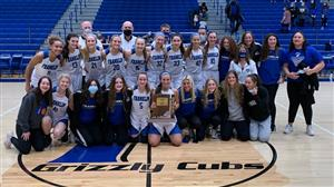 Girls Basketball posing with 2021 Sectional Trophy