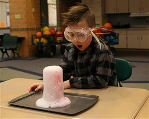 Student participating in science experiment.