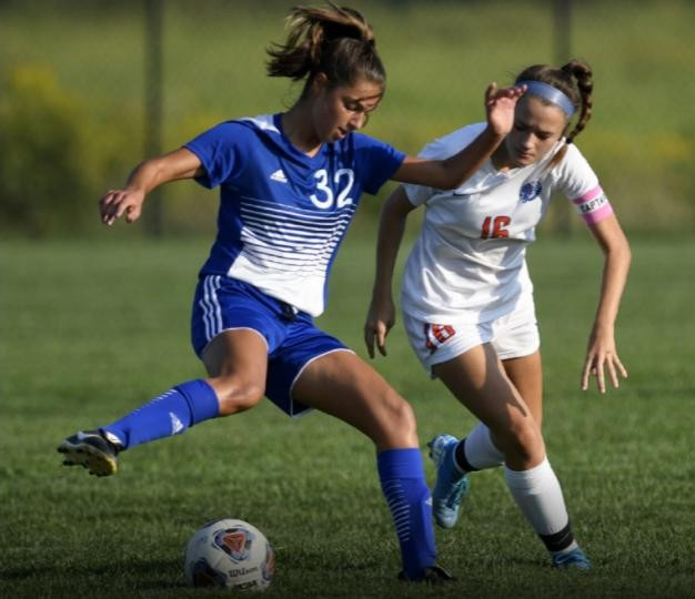 Franklin Girls Soccer player dribbles past defender
