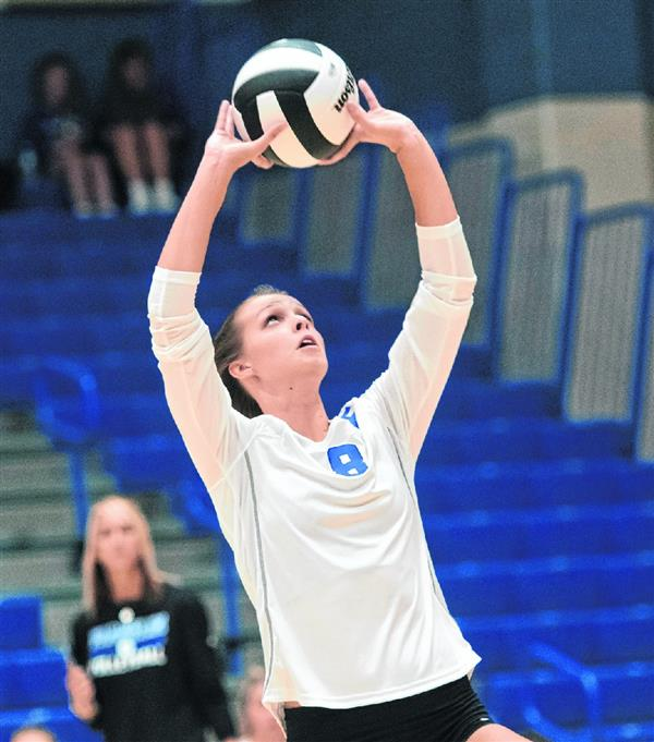 Franklin volleyball player setting the ball