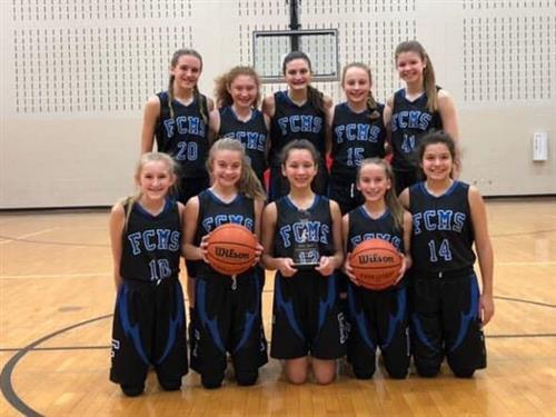 A picture of 7th grade girls basketball team being county champs