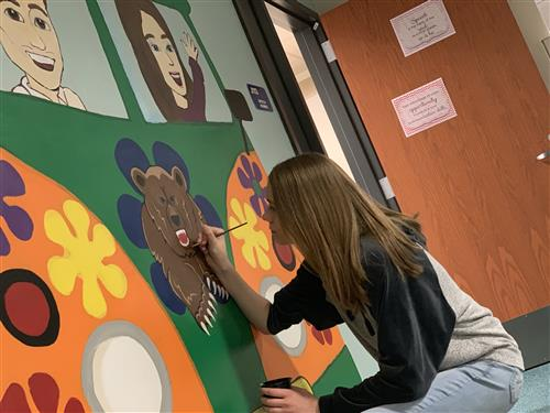 Picture of student painting mural