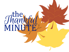 Three leaves (orange, red, and yellow) with the words the Thankful Minute in blue next to it